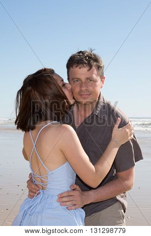Couple Kissing On The Beach On A Sunny Day