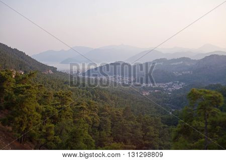 Evening view of the city of Marmaris, the mountains and the sea.