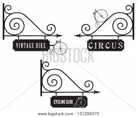 A set of street signs with the old bike for the circus shops and clubs.