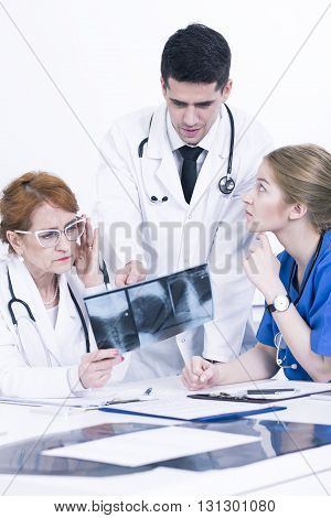 Concerned Doctors Looking At Xray