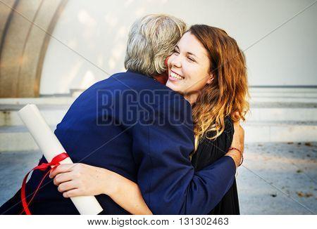 University Graduation Certificate Hugging Success Concept