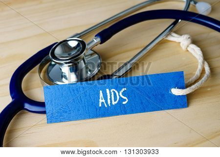 Medical Conceptual Image With Aids Words And Stethoscope On Wooden Background.