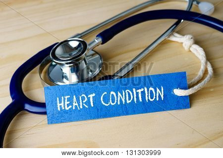 Medical Conceptual Image With Heart Condition Words And Stethoscope On Wooden Background.