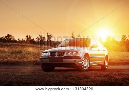 Saratov, Russia - August 20, 2014 - Car BMW E46 stay on countryside road at sunset