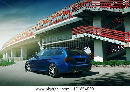 Moscow, Russia - May 10, 2015: Blue car BMW 5 series E90/E91 stay on asphalt road in the city Moscow at daytime