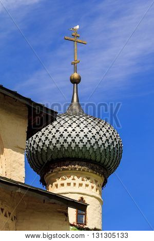 KIRILLOV, RUSSIA - MAY 28, 2013: This is ancient traditional Russian Orthodox church dome with orthodox cross.