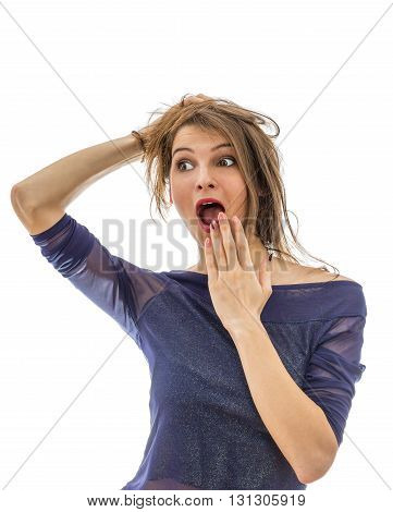 Young attractive woman screaming with surprise isolated against a white background.