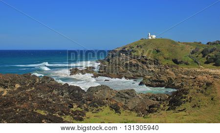 Small lighthouse on top of a hill. Pacific coast in Port Macquarie Australia.