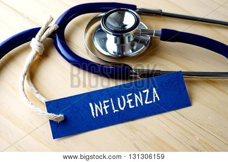 Medical Conceptual Image With Influenza Word Written On Label Tag And Stethoscope On Wooden Backgrou