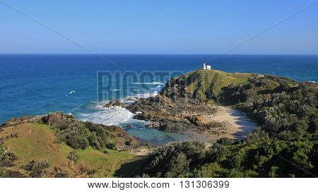 Pacific coast in Port Macquarie Australia. Blue water bay and lighthouse on top of a hill. Tacking Point Lighthouse.