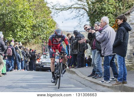 Conflans-Sainte-Honorine, France-March 6, 2016: The Belgian cyclist Ben Hermans of BMC Racing Team riding during the prologue stage of Paris-Nice 2016.