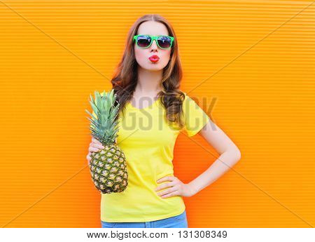 Fashion Cool Girl In A Sunglasses With Pineapple Over Colorful O