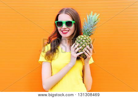 Fashion Cool Smiling Girl In Sunglasses With Pineapple Over Colo