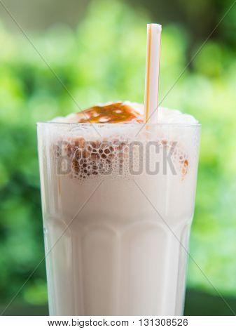 milkshake, glass milk shake in the cafe garden