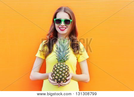 Pretty Cool Smiling Girl In Sunglasses With Pineapple Over Colorful Orange Background