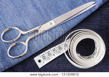 corduroy pants and blue jeans with scissors and a meter