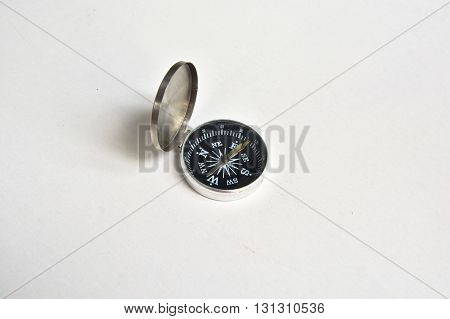 Lone compass. The magnetic compass is located on a white background.