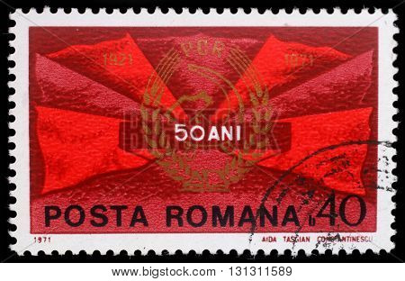 ZAGREB, CROATIA - JULY 19: a stamp printed in Romania shows Red flags and communist party badge, 50 years P.C.R., circa 1971, on July 19, 2012, Zagreb, Croatia