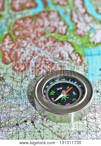 The compass on the map. Magnetic compass is located on a topographic map.