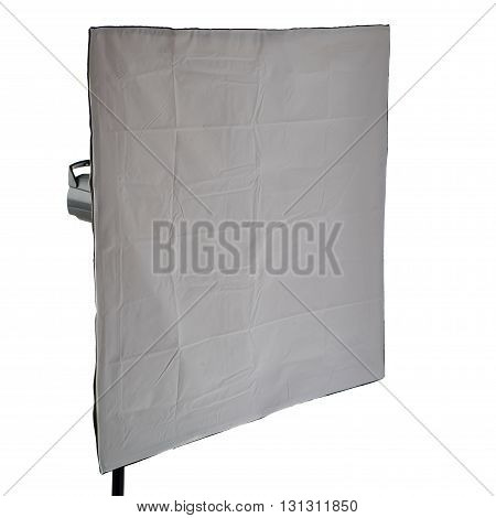 studio flash with square softbox on a stand over isolated white background