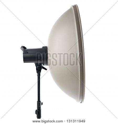 studio flash with beauty dish on a stand over isolated white background