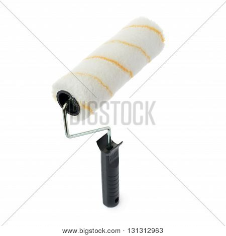 Unused paint roller over isolated white background