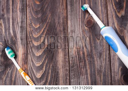 Electric Toothbrush on a black wooden background.