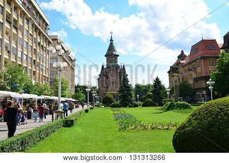 TIMISOARA ROMANIA - 05.13.2016: revolution square with cathedral building in background