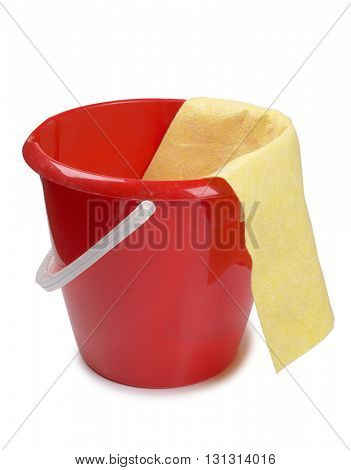 Red plastic bucket and rag on white background