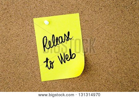 Release To Web written on yellow paper note pinned on cork board with white thumbtack copy space available