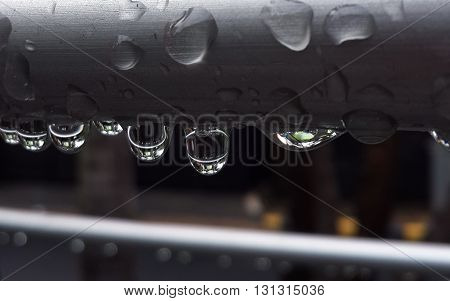 a clear view of a raindrop on a pipe