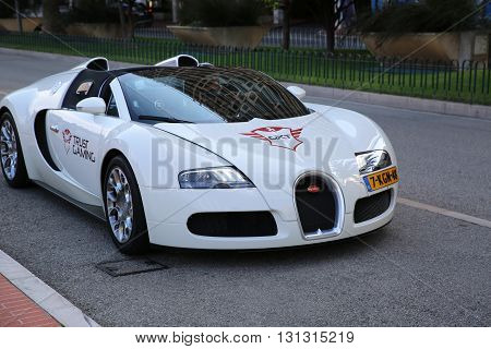 Monte-Carlo Monaco - May 17 2016: White Supercar Bugatti Veyron 16.4 Grand Sport Parked in Front of the Grimaldi Forum in Monaco