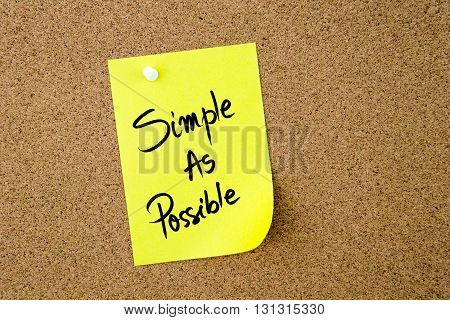 Simple As Possible Written On Yellow Paper Note