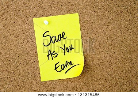 Save As You Earn Written On Yellow Paper Note
