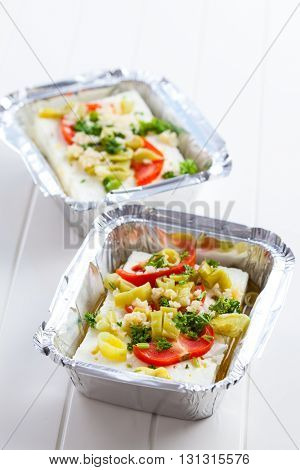 Feta cheese in baking pan for grill