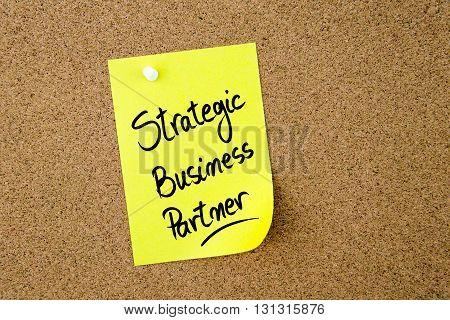 Strategic Business Partner Written On Yellow Paper Note