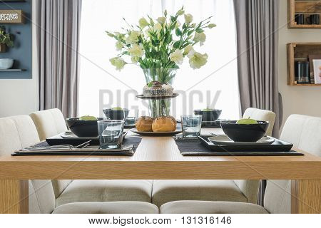 Table Set On Wooden Table In Dinning Room Design