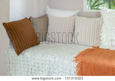 Modern Living Room With White Sofa And Set Of Pillows