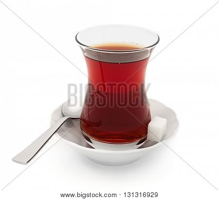 Turkish tea served in traditional glass isolated on white background
