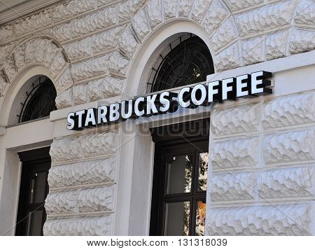 BUDAPEST HUNGARY - MAY 16: Starbucks coffee sign on coffeeshop in Budapest on May 16 2016. Starbucks is the largest coffeeshop chain in the world.