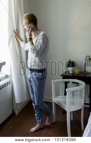 Young Redhair Man With Phone