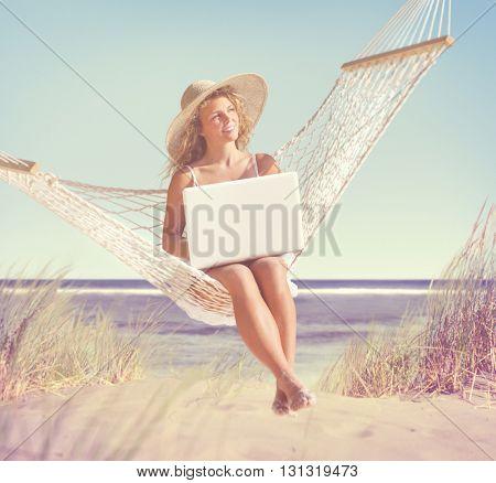 Beautiful Woman Sitting on a Hammock by the Beach