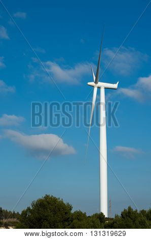 Wind turbines blades on the countryside against a blue sky