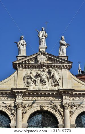 Detail of the beautiful St Vincent baroque church in the center of Vicenza with statue of Jesus angels and saints (17th century)