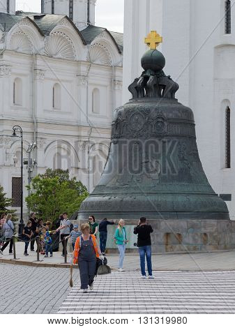 Moscow - May 7 2016: Many tourists are photographed near the Tsar Bell on the Kremlin territrii May 7 2016 Moscow Russia