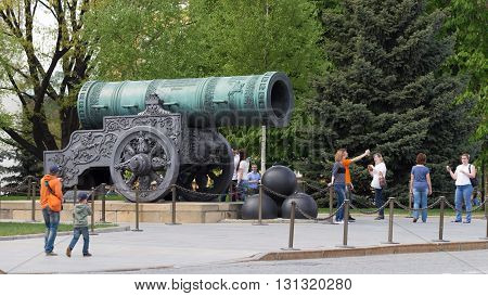 Moscow - May 7 2016: Tourists are photographed near the Tsar Cannon at the Kremlin territrii May 7 2016 Moscow Russia