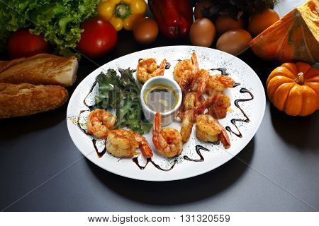 Haute cuisine, large shrimp with sauce