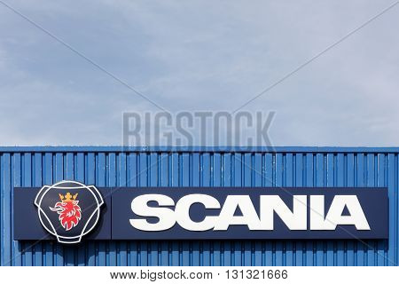 Horsens, Denmark - July 4, 2015: Scania sign on a wall. Scania is a major swedish automotive industry manufacturer of commercial vehicles specifically heavy trucks and buses.