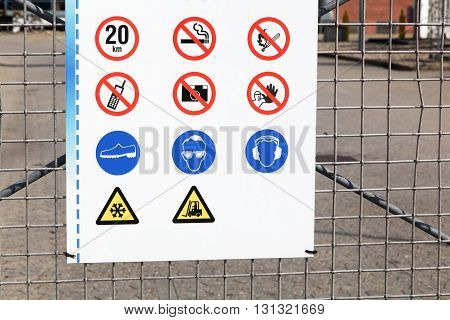Safety signs at the entrance of an industrial site