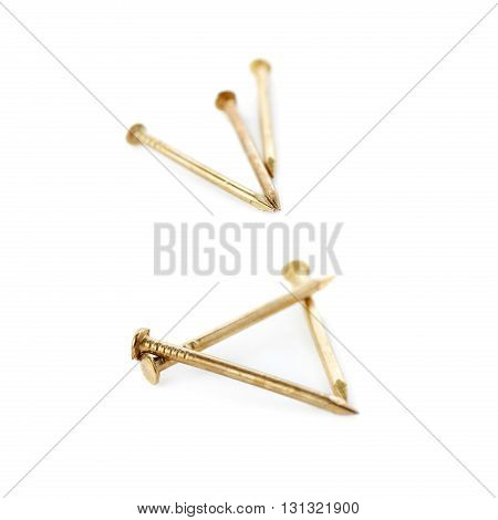 Small golden Pail of Metal nails isolated over the white background